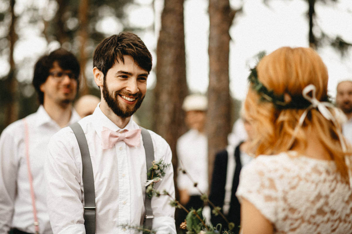 groom smiling at his future wife