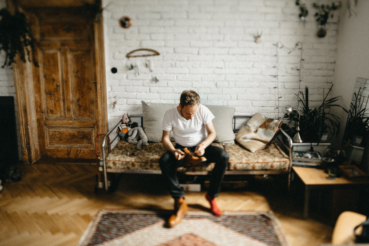 a groom getting ready in his hipster apartment