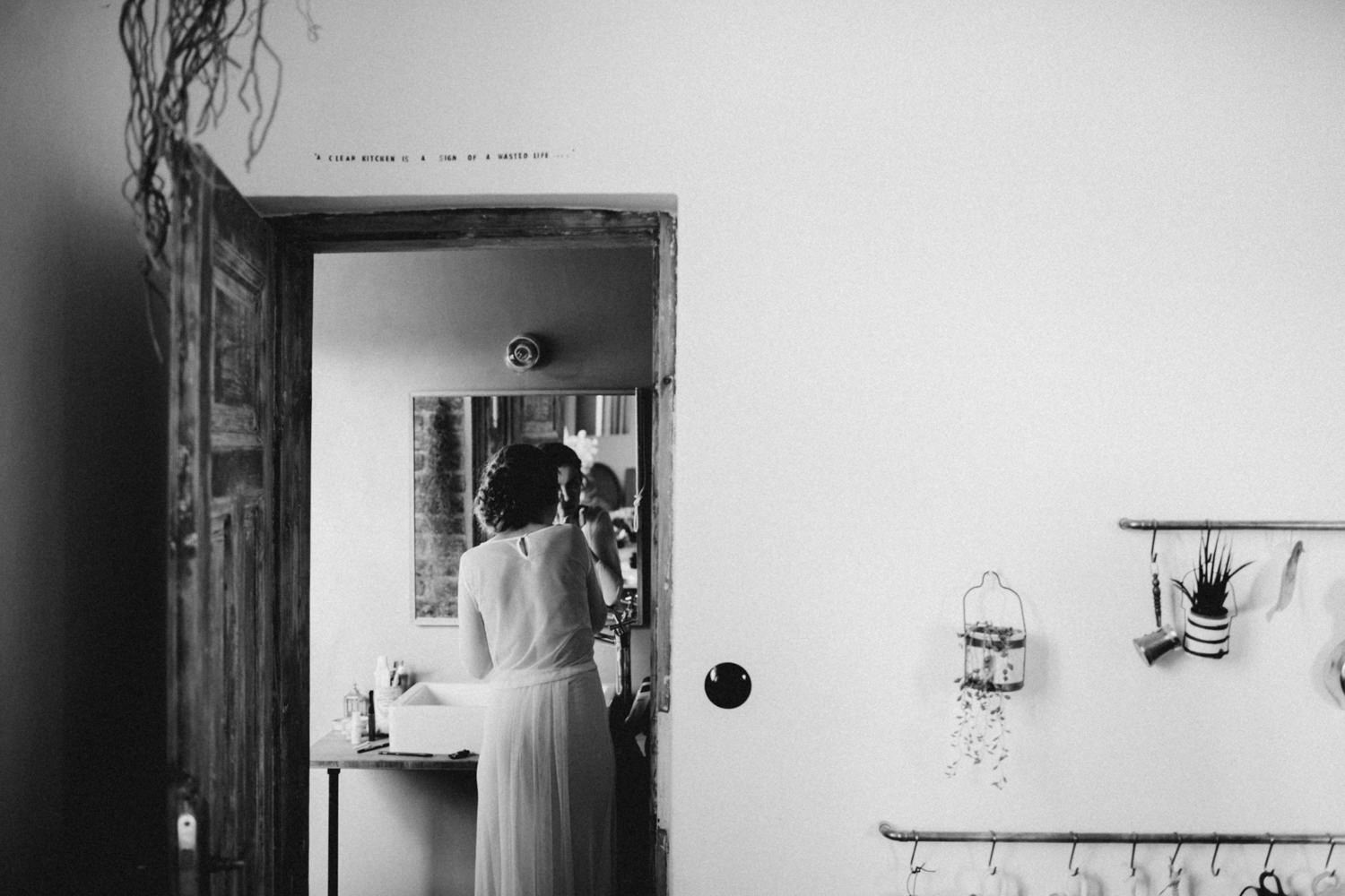bride finishing her getting ready