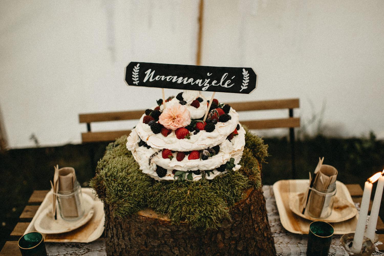 wedding cake sitting on a moss