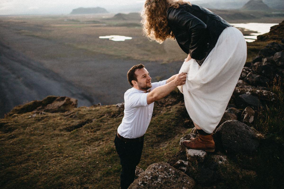groom helping the bride