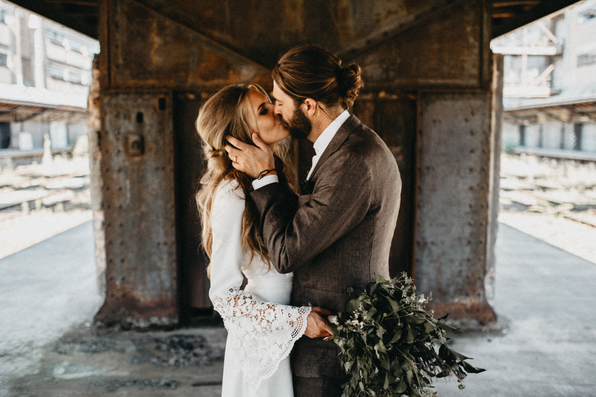 hipster couple kissing in hipster location