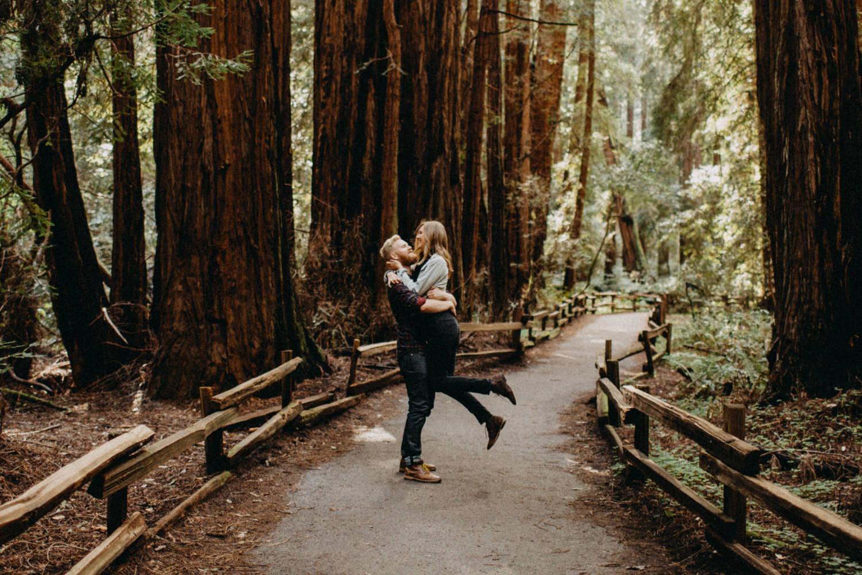 happy couple dancing in the woods
