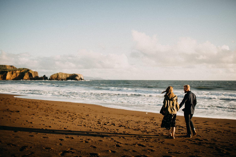 walking towards the sunset on the coast