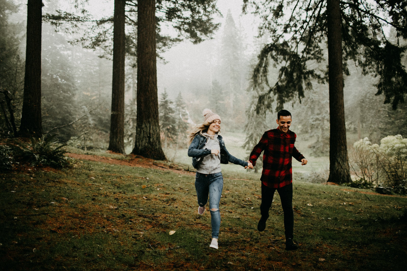 couple running around forest in portland
