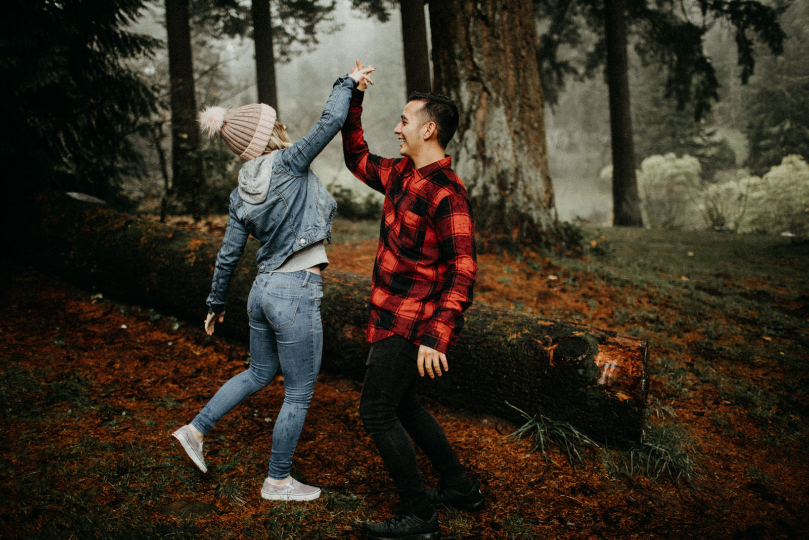 engaged couple celebrating with a high five