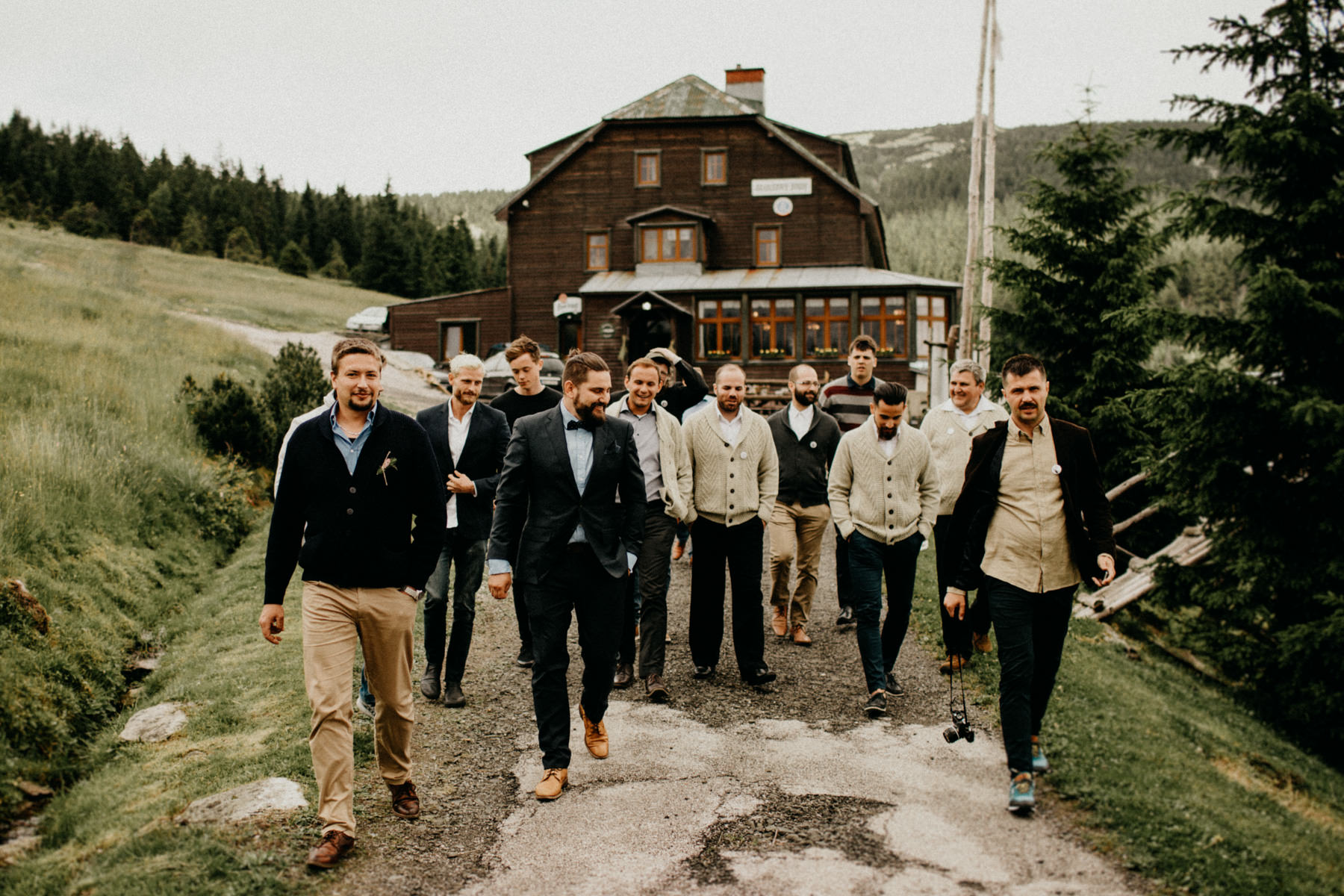 groom with his groomsmen walking to their secret spot
