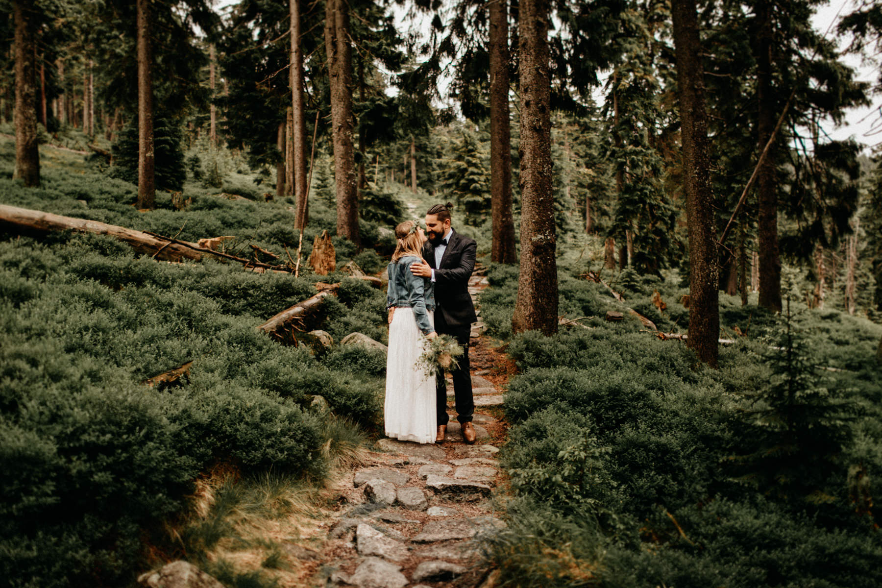 epic portrait of a hipster wedding couple in the forest