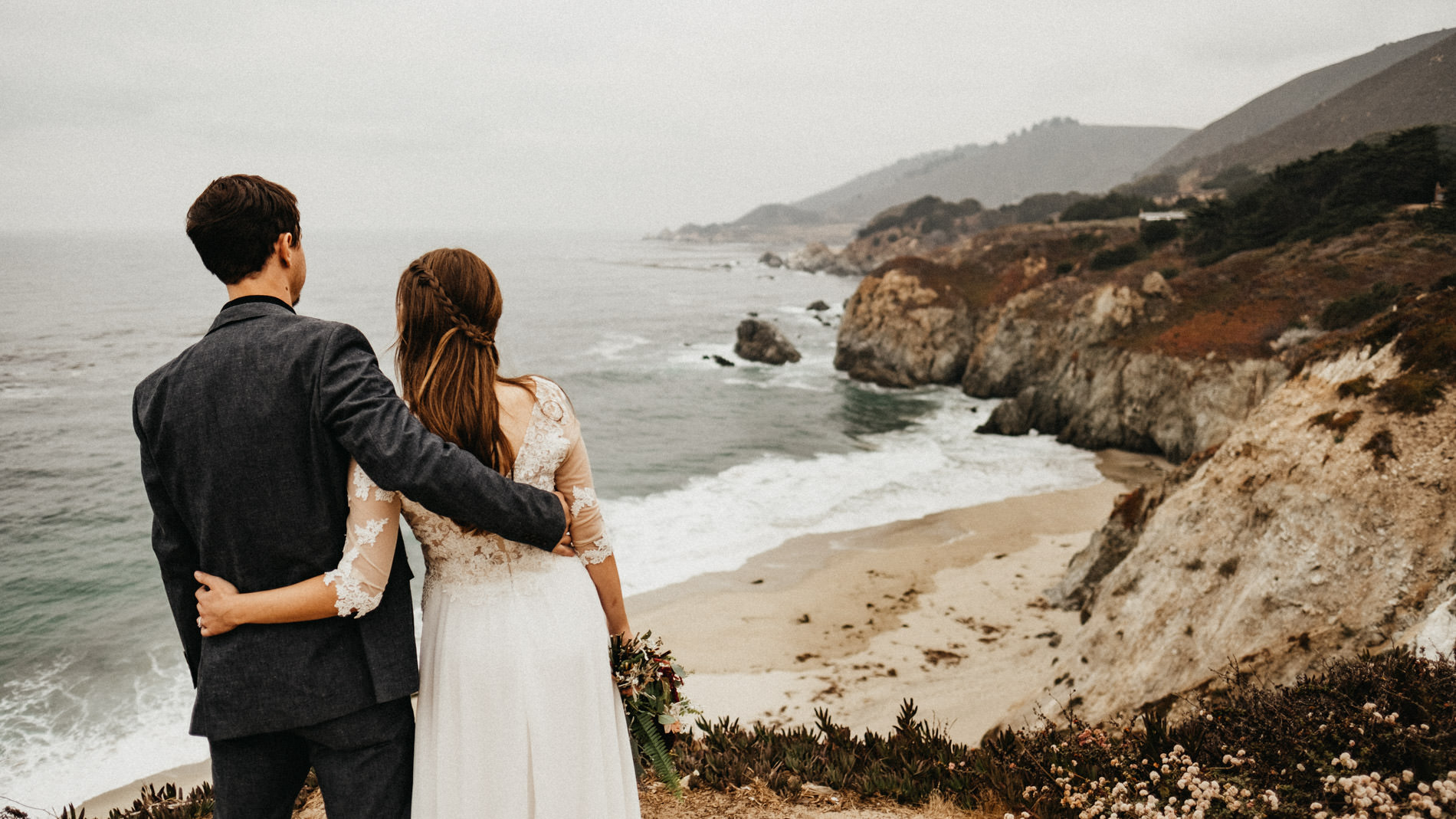Bride and groom enjoying the view on the Big Sur coast.