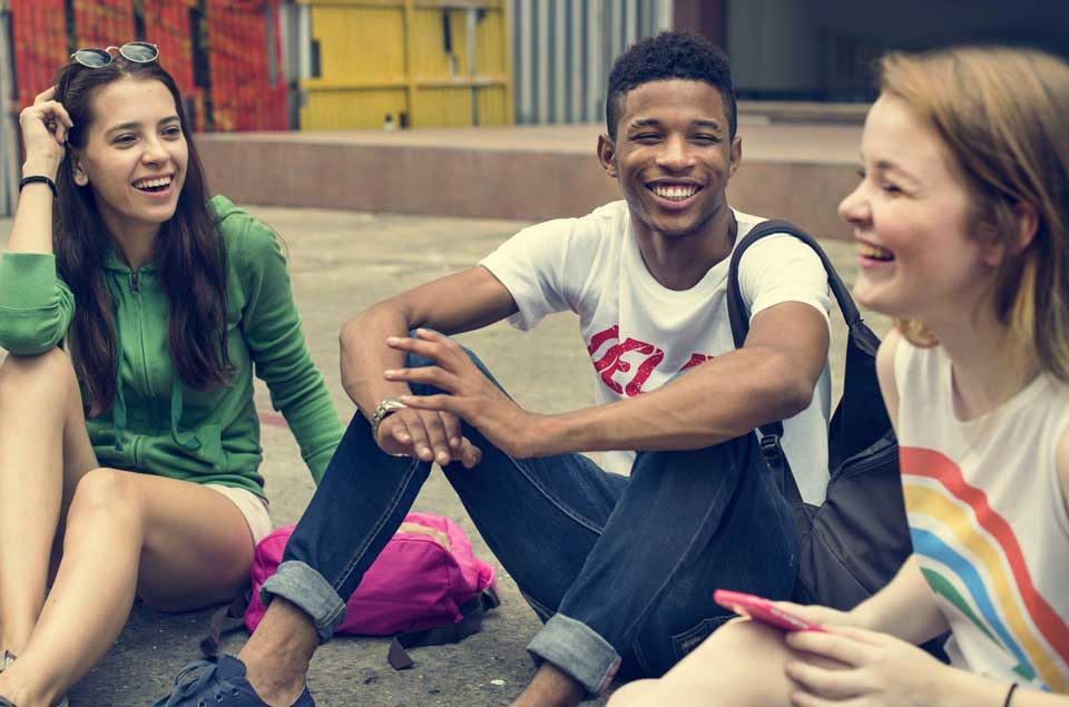 group-of-teens-sitting-in-a-circle-laughing.jpg