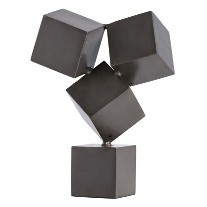 Stockton Sculpture - Cubist…Brutalist…Industrial? This dark natural iron tabletop sculpture qualifies as all three. These four cubes, balanced on-pointe, create a visual tension that will garner a second look in any room. Perfectly sized for a bookcase or tabletop.H: 15in W: 12in D: 7.5in