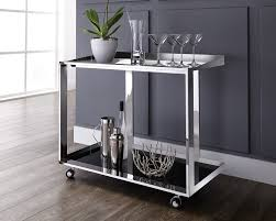 Maddox Bar Cart - A contemporary bar cart offering style and functionality. Featuring a polished stainless steel frame with black glass shelving for storage and display, with castors for easy mobility.36