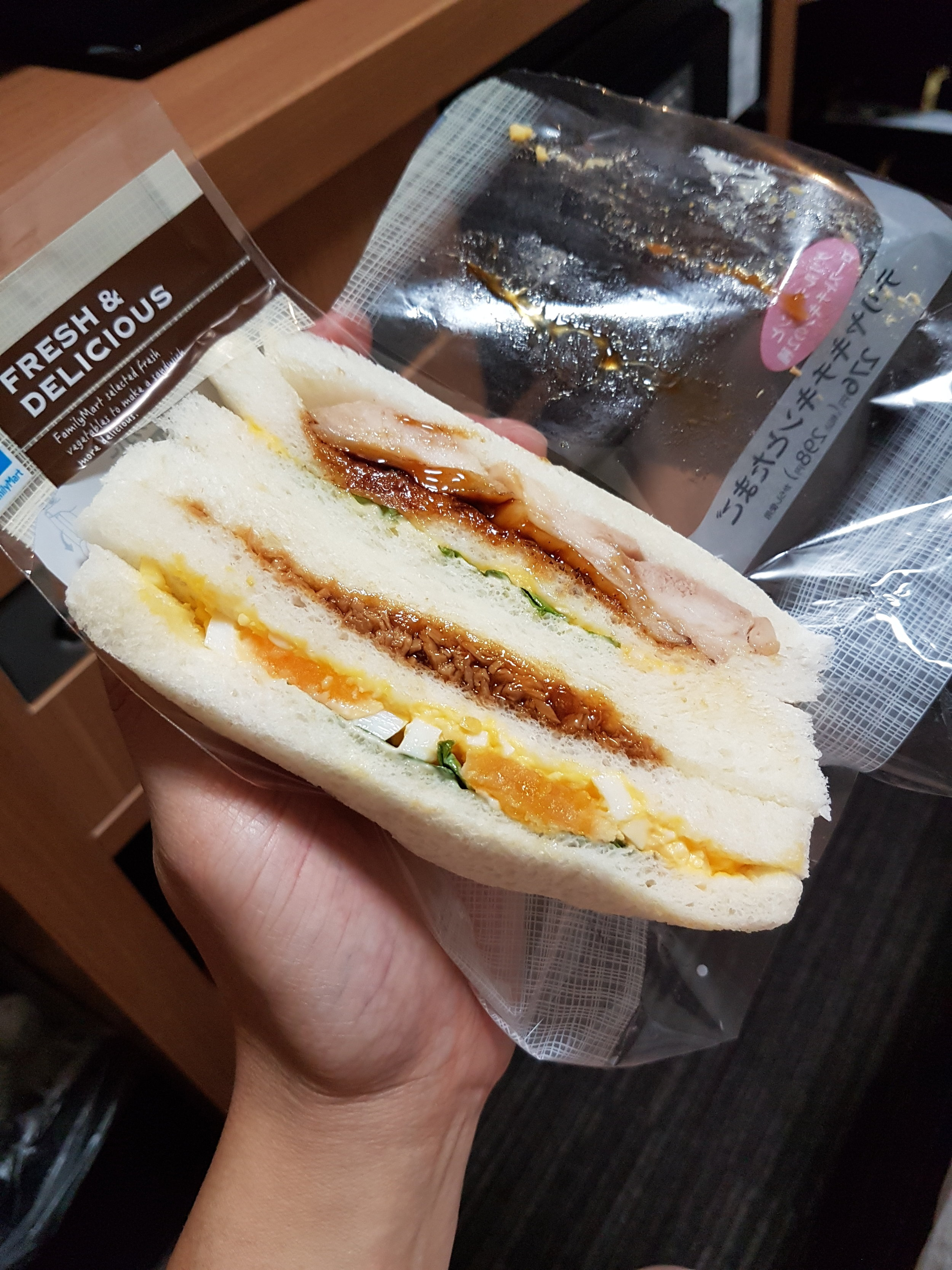 Family Mart's sandwiches... egg salad + chicken teriyaki and ground pork!