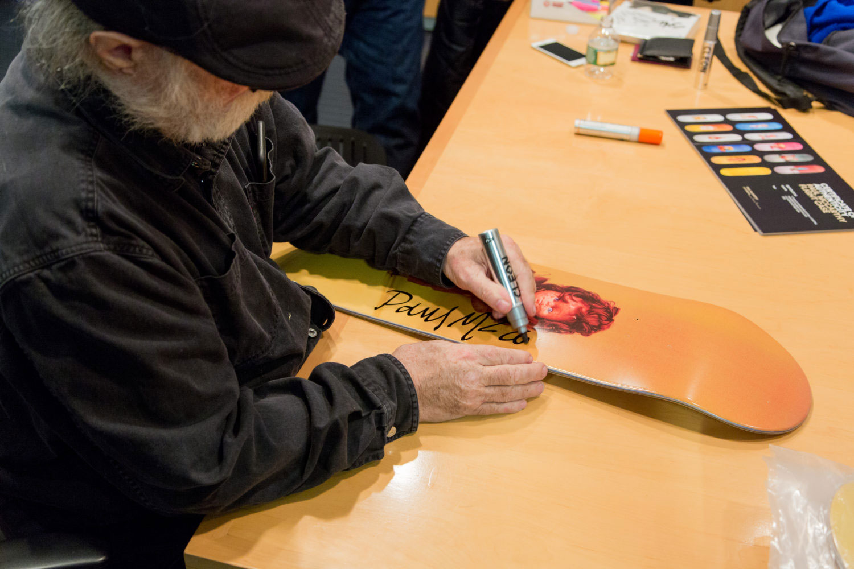 Paul McCarthy signs boards at MOMA