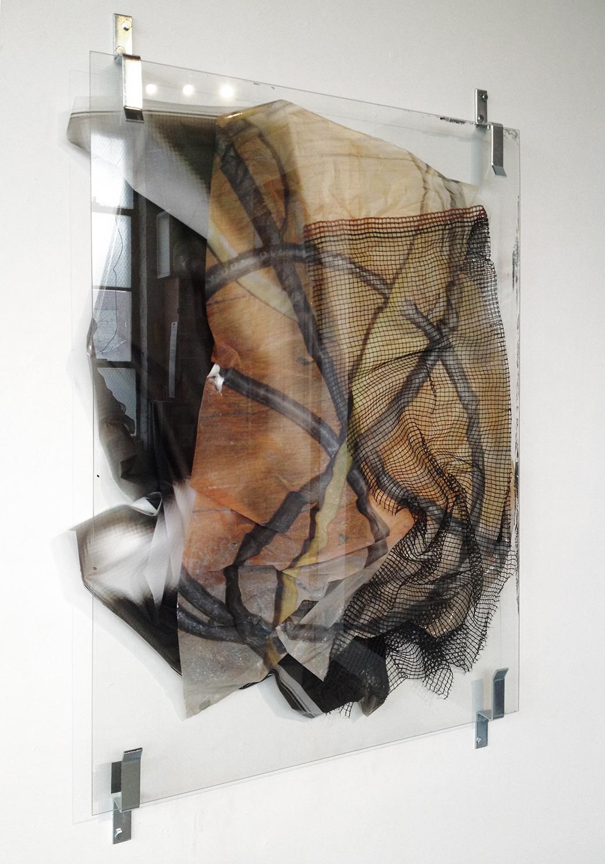 Valerie Snobeck, Standard Extension,  2012,partially removed mirror, peeled print on plastic, debris netting, door barricade brackets,121,9 x 91,4 cm
