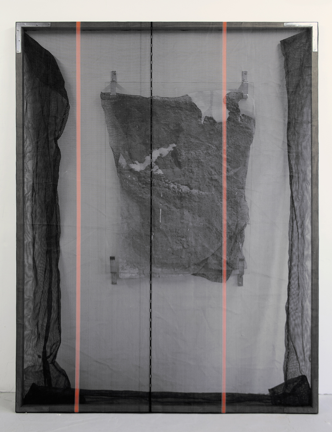 Valerie Snobeck, Distance Approcimated by Buoyancy,  2012,Debris netting, partially removed mirror, peeled print on plastic, door barricade brackets, wood, hardware, 243,9 x 182,9 cm