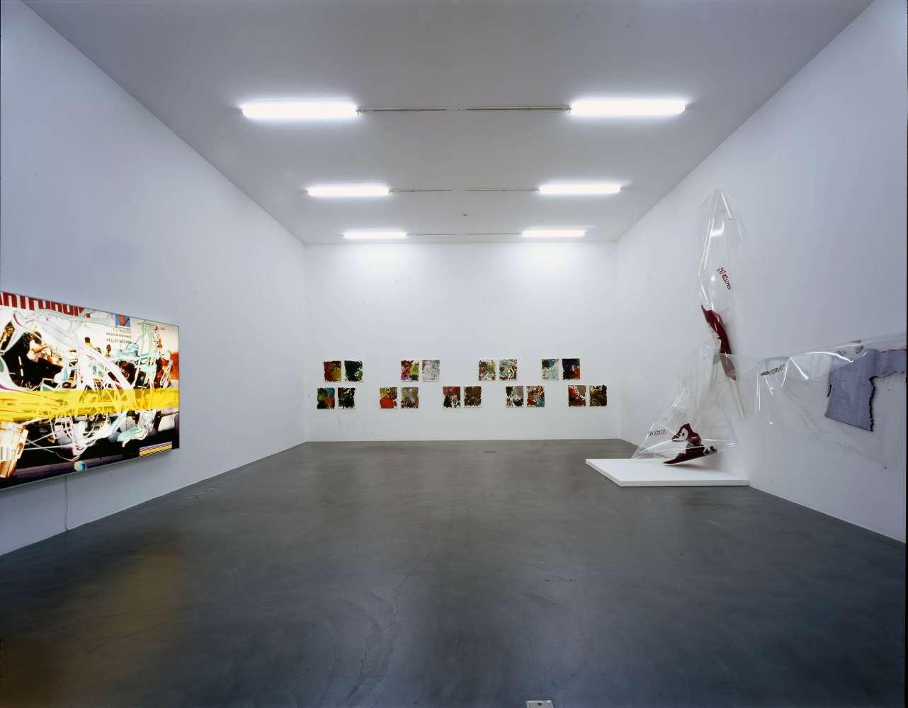 Installation view Wade Guyton, Seth Price, Kelley Walker, Josh Smith, Kunsthalle Zurich, 2006.  © Photo : Stefan Altenburger Photography