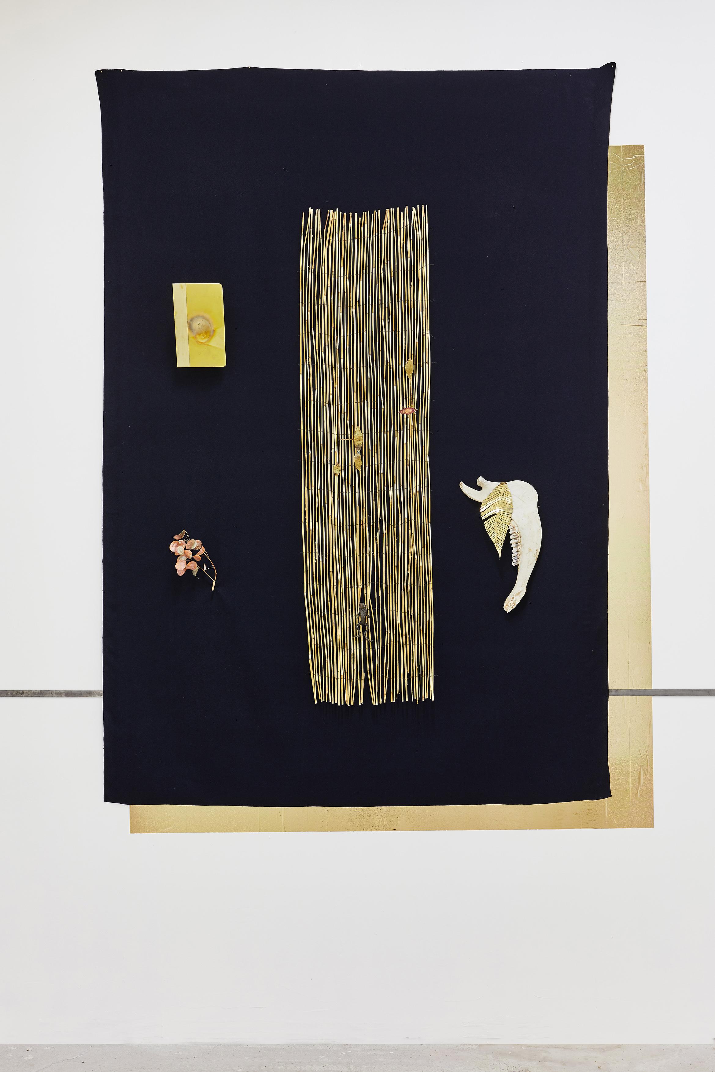 Le radeau,  2019. Laine, canisse, laiton, monnaie du pape, cuivre, machoire de cheval, grenouille