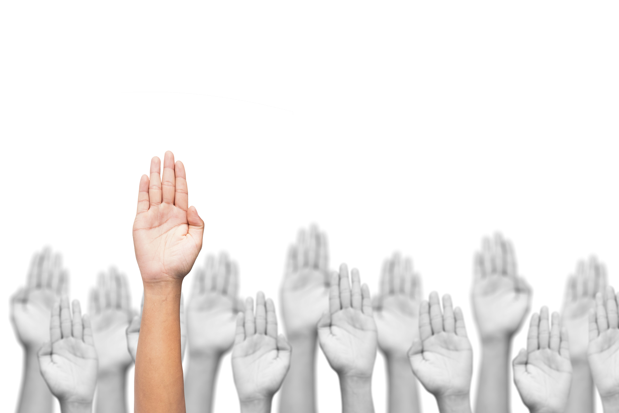 Volunteer With Unspoken Voices Raised Hands Image (Licensed through Getty Images)