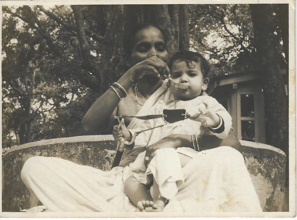 Soondra feeding me on vacation in the hills (I'm around 9 months old here).