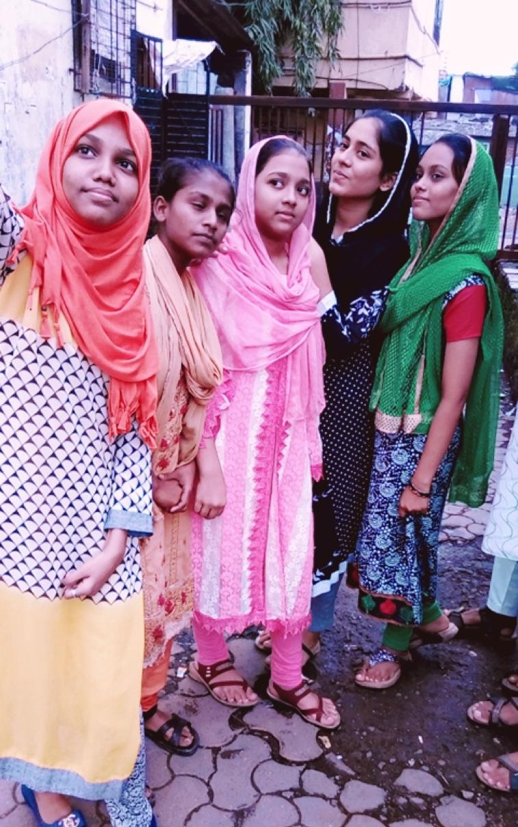 Samina (orange scarf) with her friends