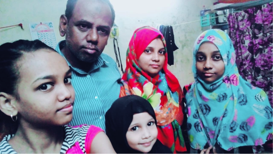 Samina with her Dad, Mom (red scarf) and sisters, August 2018.