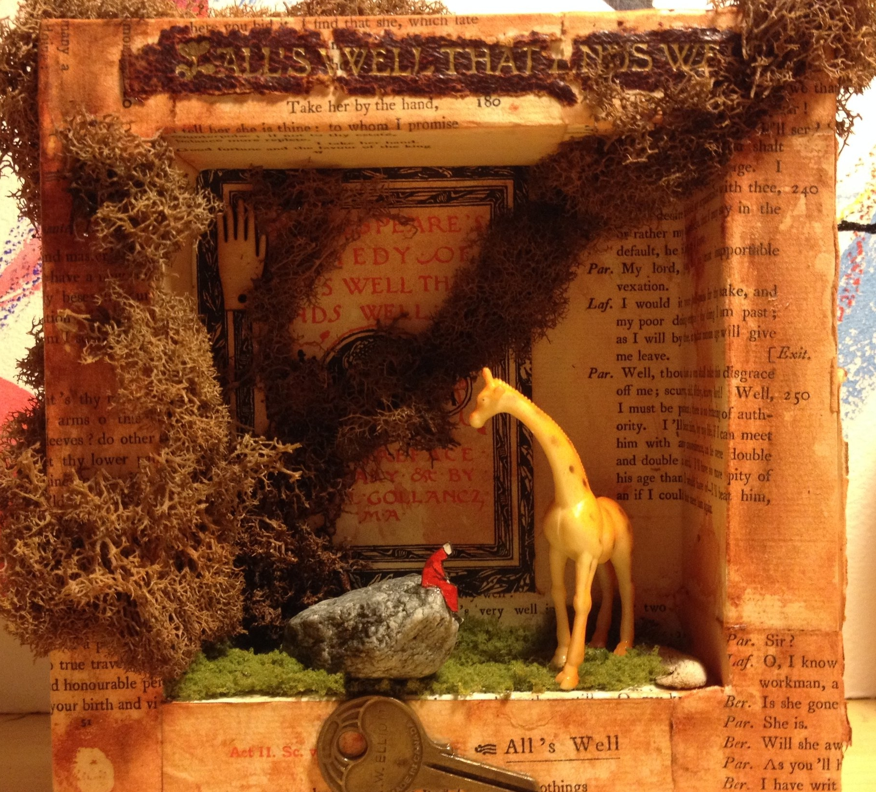 Giraffe.    15cm X 15cm.  Wood, paper, moss, rock, toy. 250.00$
