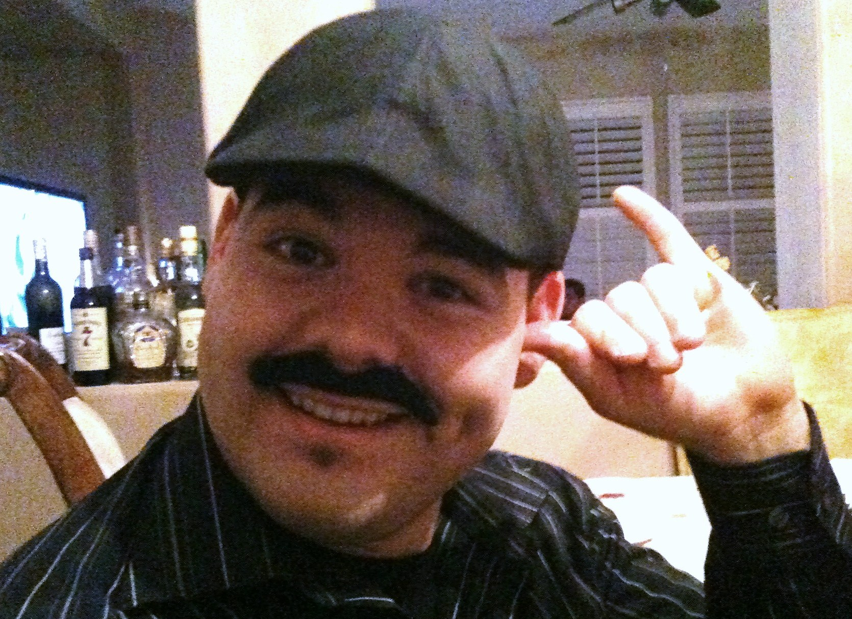 Get that thumb out of your ear, so you can hear all of the compliments on that bitchin' 'Stache!
