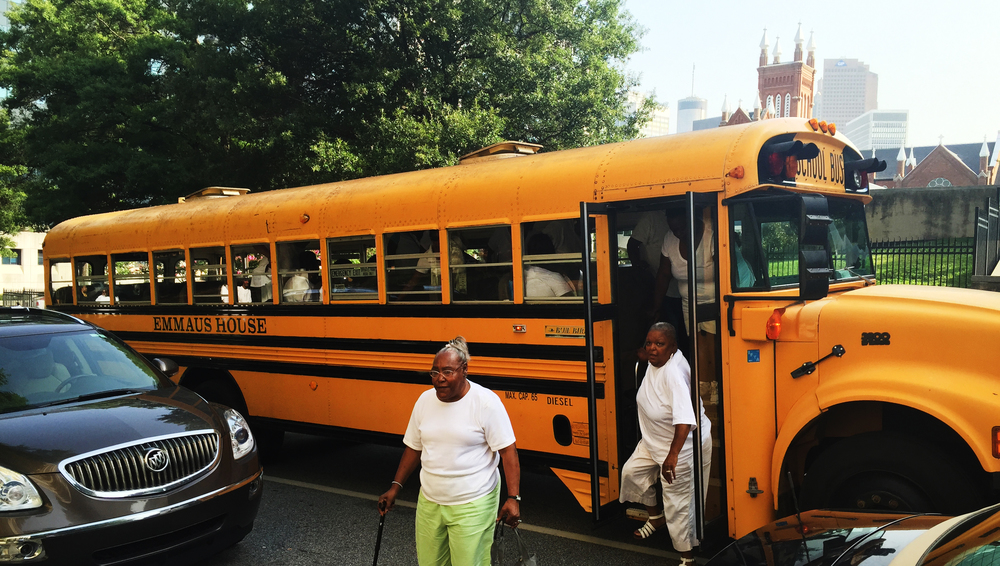 Peoplestown residents leave the Emmaus House bus at City Hall