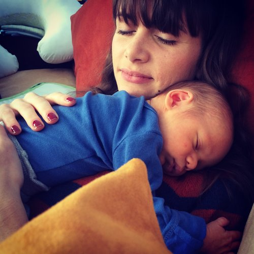 Woman Holding Sleeping Infant.jpeg