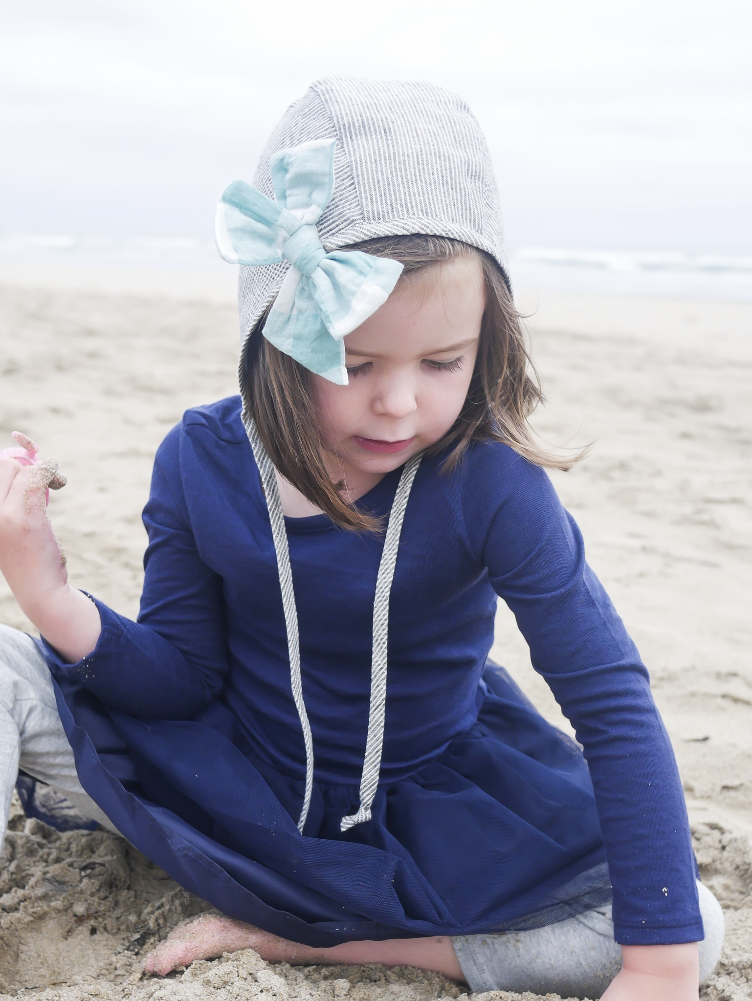 The Oregon Coast beaches are a mild but year-round perfect vacation spot when traveling with kids