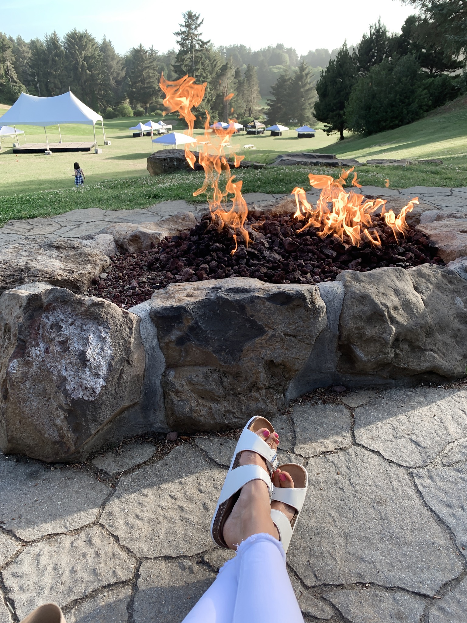 Relax on the 205-acre property with a glass of wine by one of the firepits
