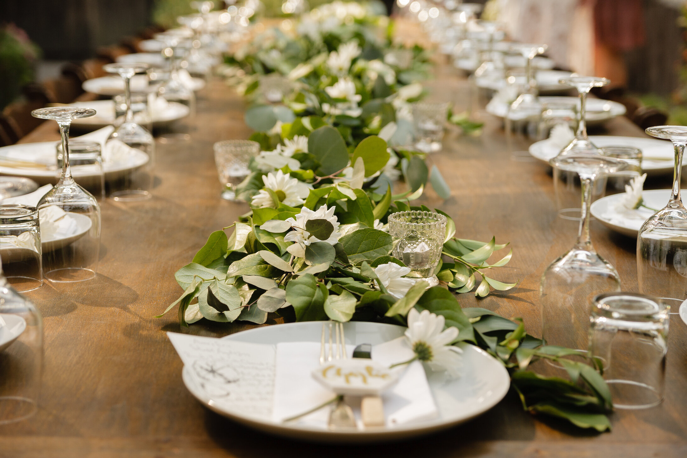 plates and flowers on wedding table.jpg