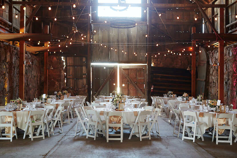 barn wedding venue with white chairs.jpg
