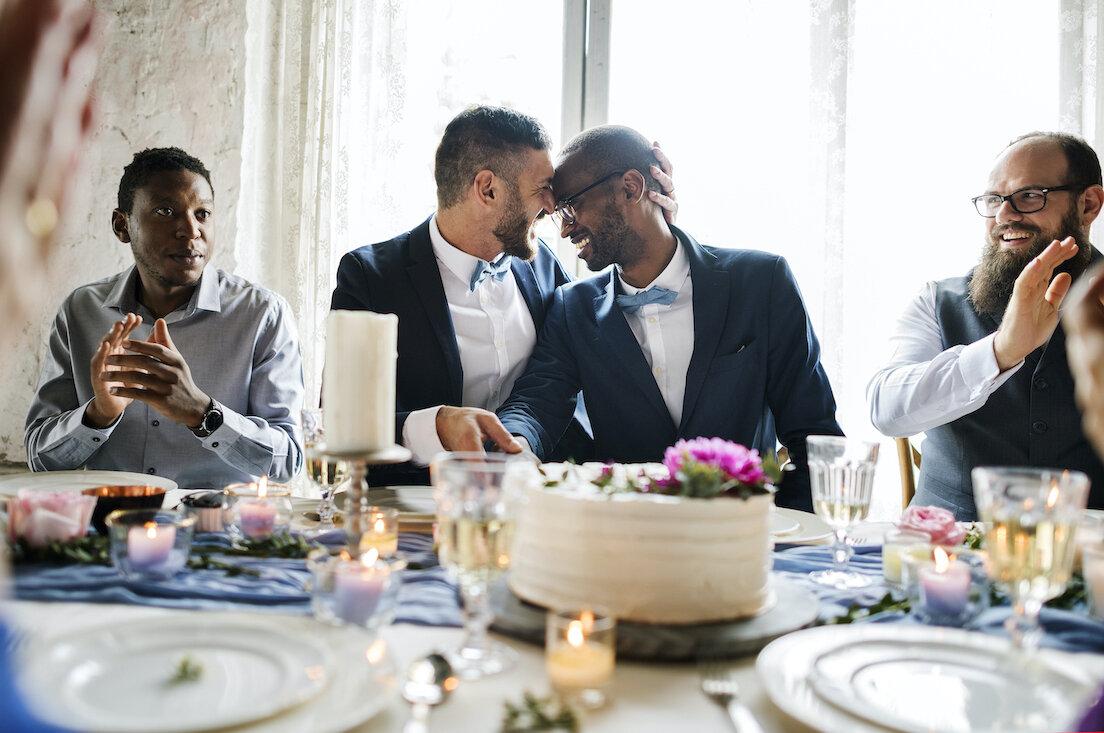 grooms smiling during wedding dinner.jpg