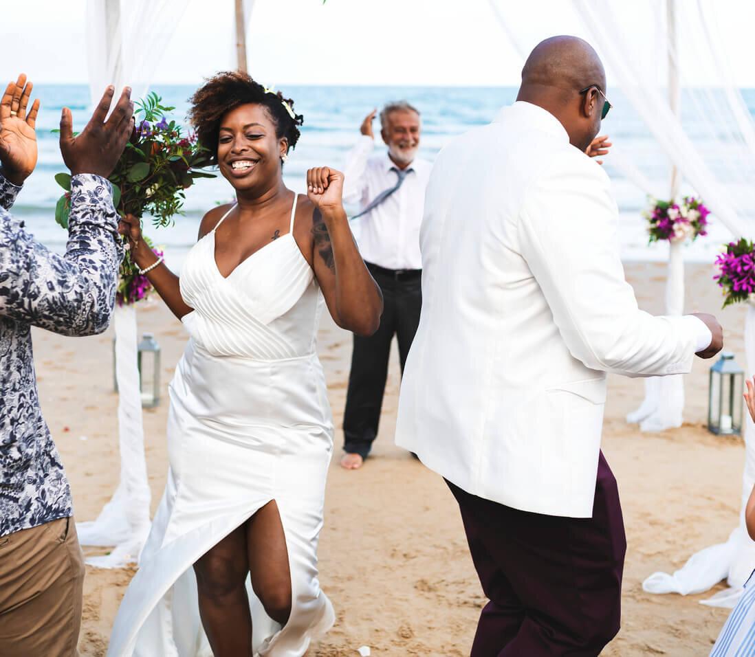 bride and groom having fun first dance on beach .jpg