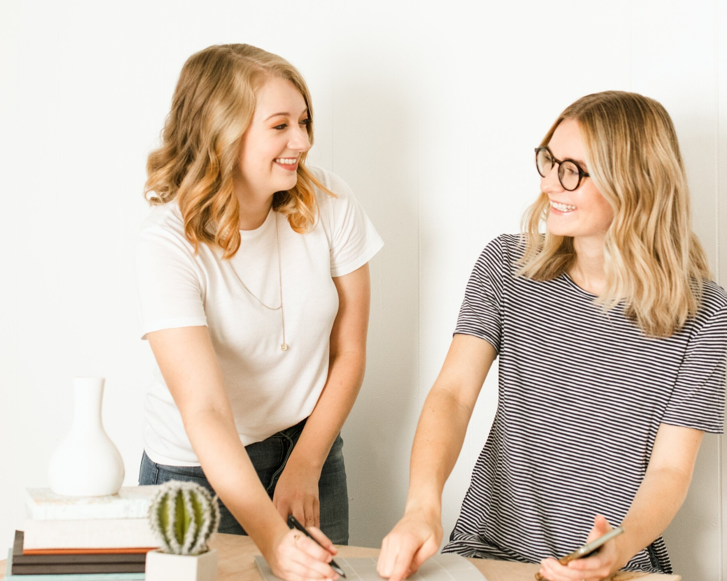 """Hello There! - We're Cassidy and Amanda, the co-founders and creatives behind Foxtrot Branding. When we met each other, we realized that Amanda's design style and entrepreneurial ideas perfectly compliment Cassidy's photography and web design background, and so we merged our services to create Foxtrot Branding. When it comes to business, we value thoughtfully designed brands that turn your prospects into paying customers. We don't just design """"pretty things"""" — we believe in having a problem-solving mindset when creating strategically branded visuals for your business. Are you wanting to change the perception of your brand to one that is reliable, professional, and reaches your dream customers? Are you hoping to upgrade your prices and offerings but need a refined look to reflect the new you? We know how to help you reach those goals with our skills in Brand Identity Design, Website Design, and Brand Photography. Whether you're ready to invest in one of our services or several, we are here to meet you where you're at in your business and lead you to where you want to be."""
