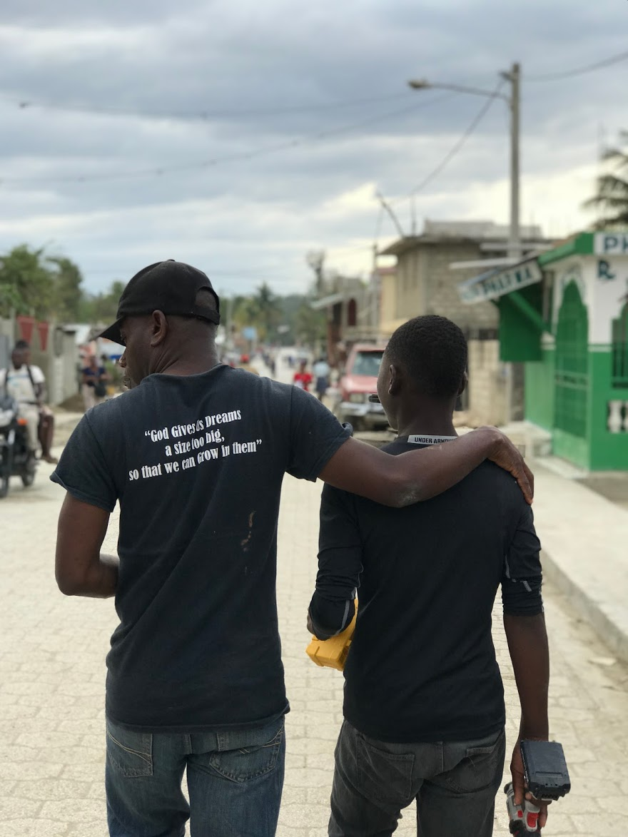 Jérémie, left, accompanies one of the orphanage's young men in Hinche.