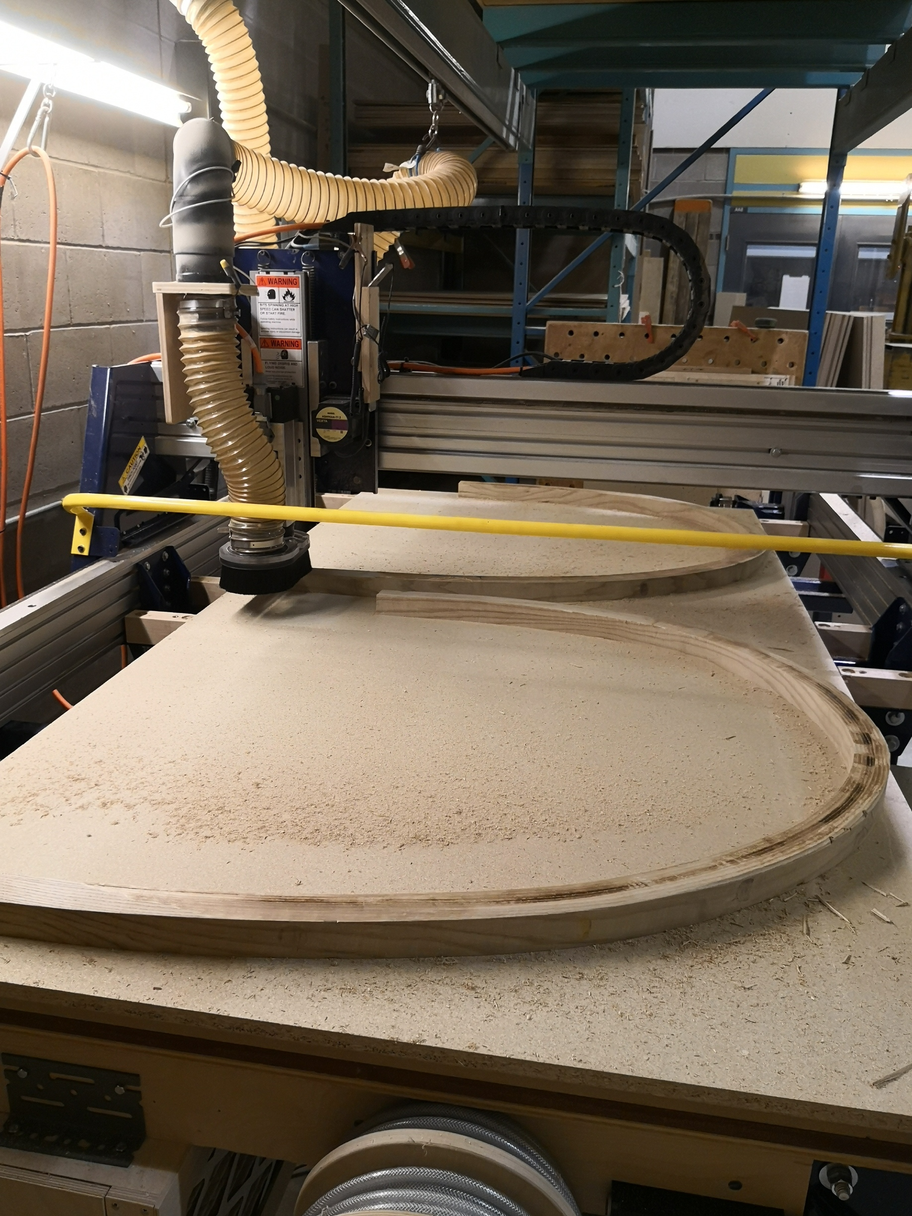Using CNC router to flush trim top surface of steam bent parts