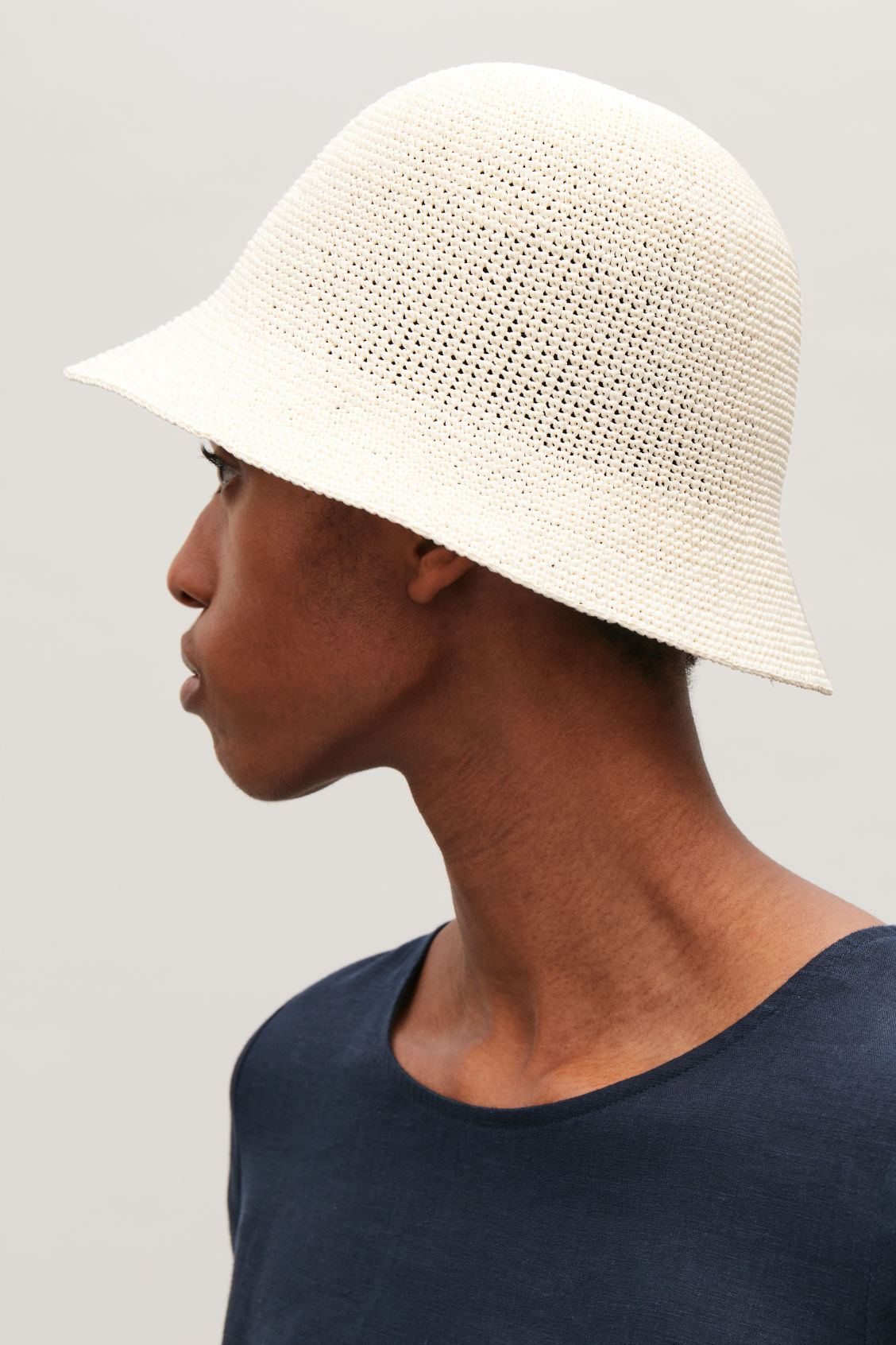 Protect your nape with a cute bucket hat. - Cos, £29