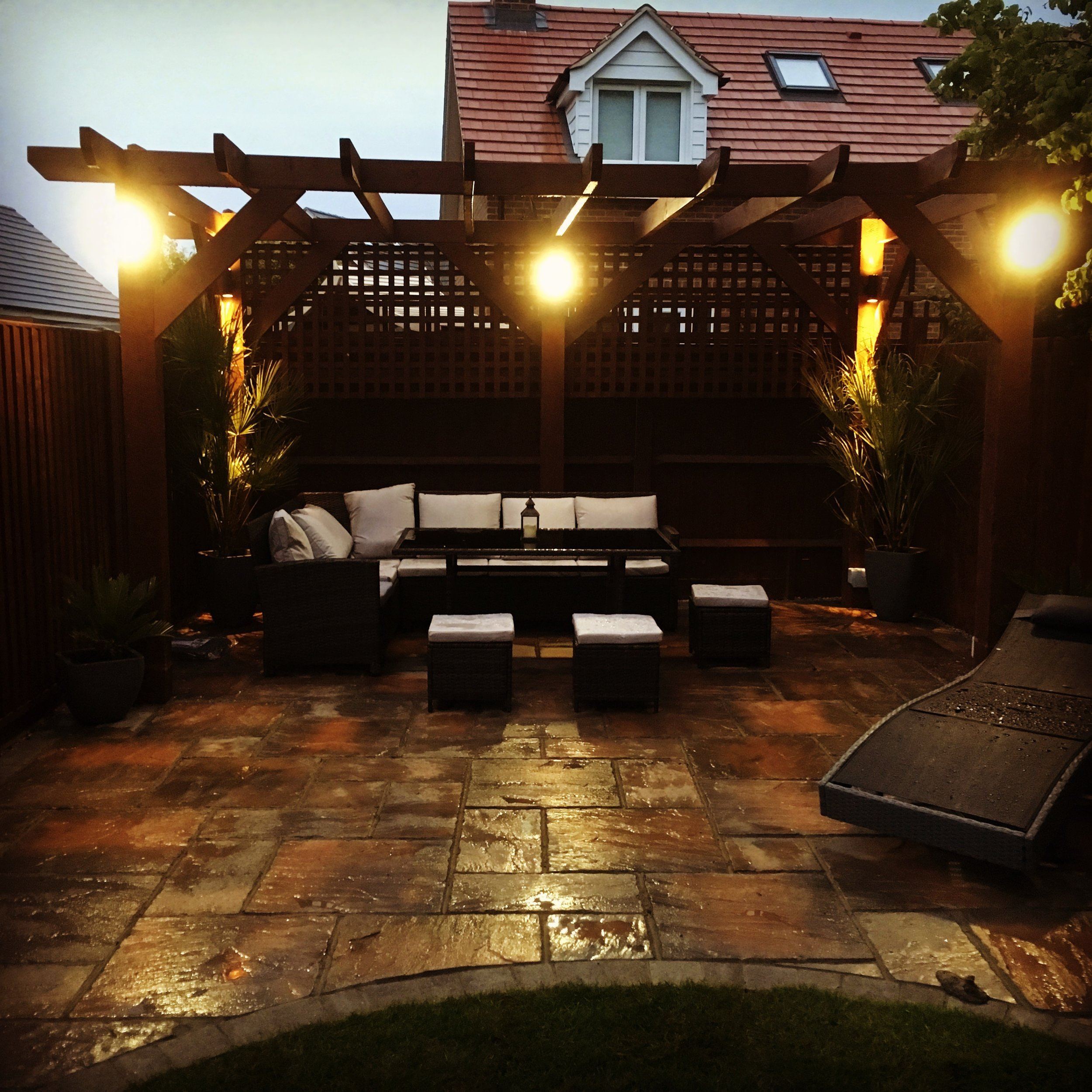 Here we have installed a new patio using the Brett Bronte paving, a new pergula made to measure and built on site with lighting installed which works from a movement sensor and switch.