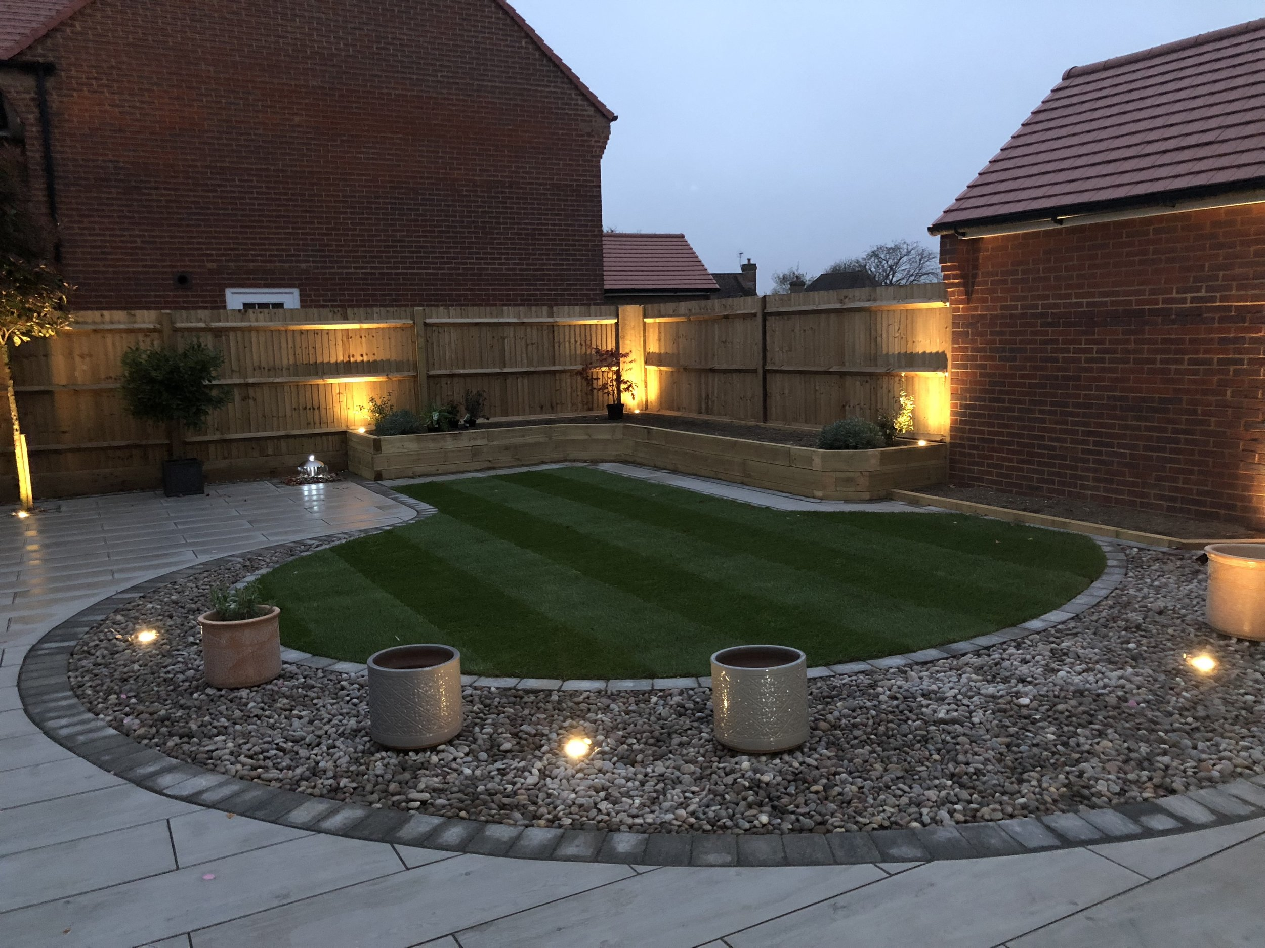 Om this garden makeover we used lights all around the garden, within the paving as well as in the planters we created, this garden is stunning at night.