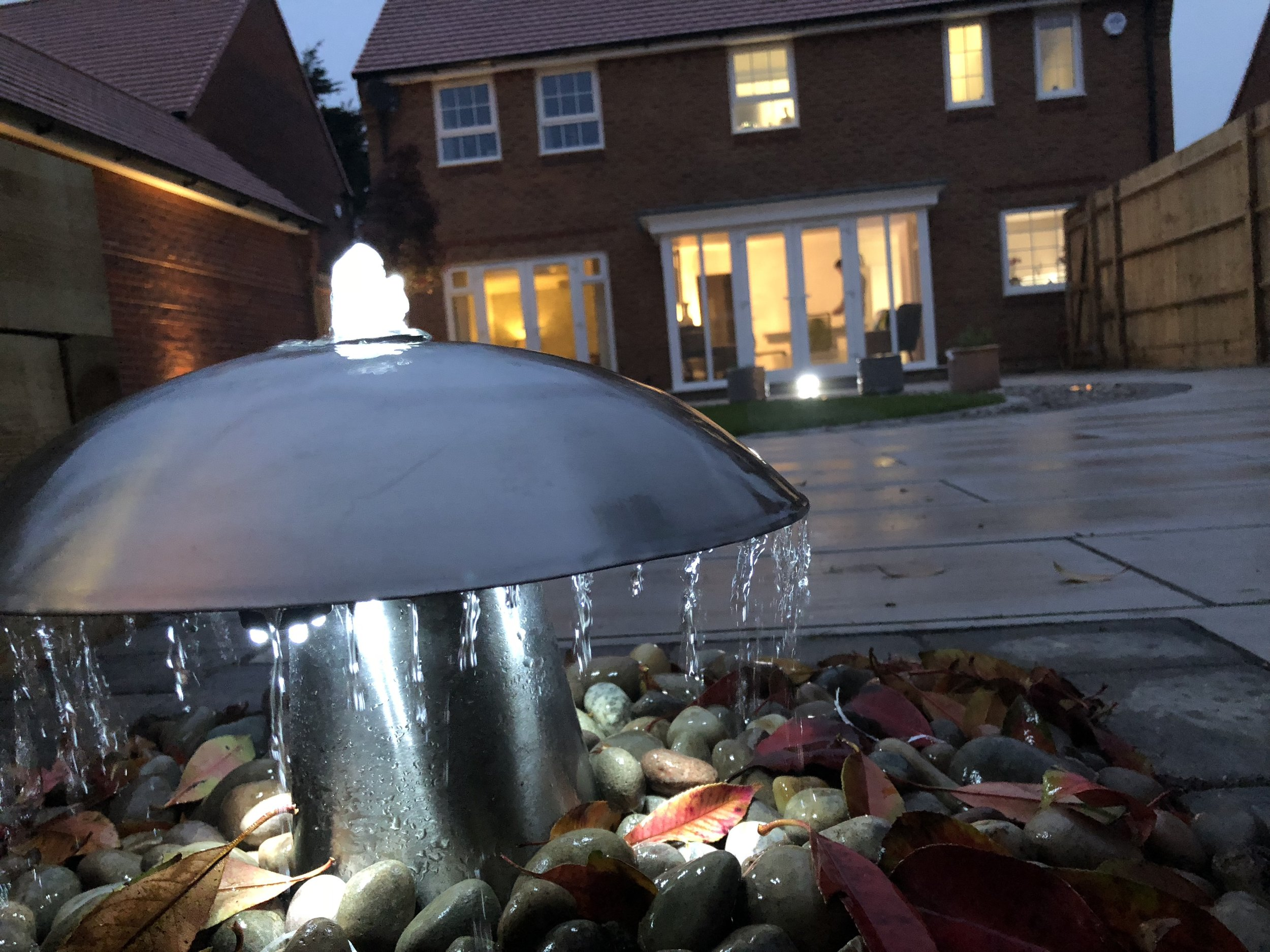 Installing a water feature in this garden with lighting, creating a really nice ambience.