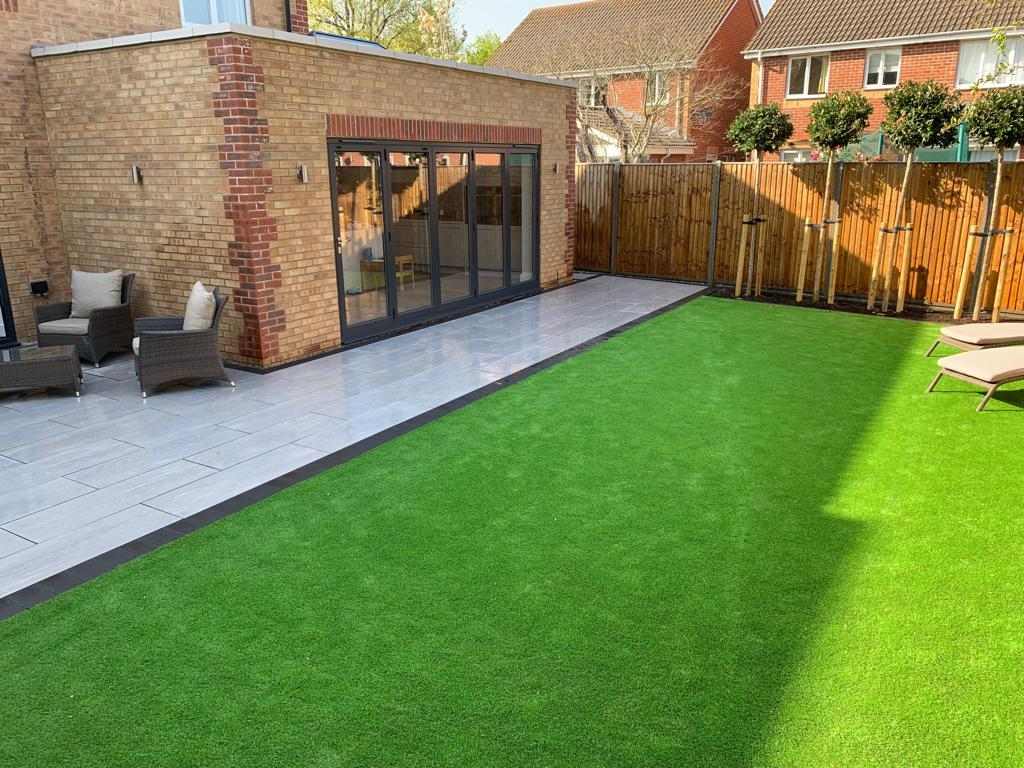 Using the Elegant porcelain in greige with artificial grass, installed in Hambrook near Chichester