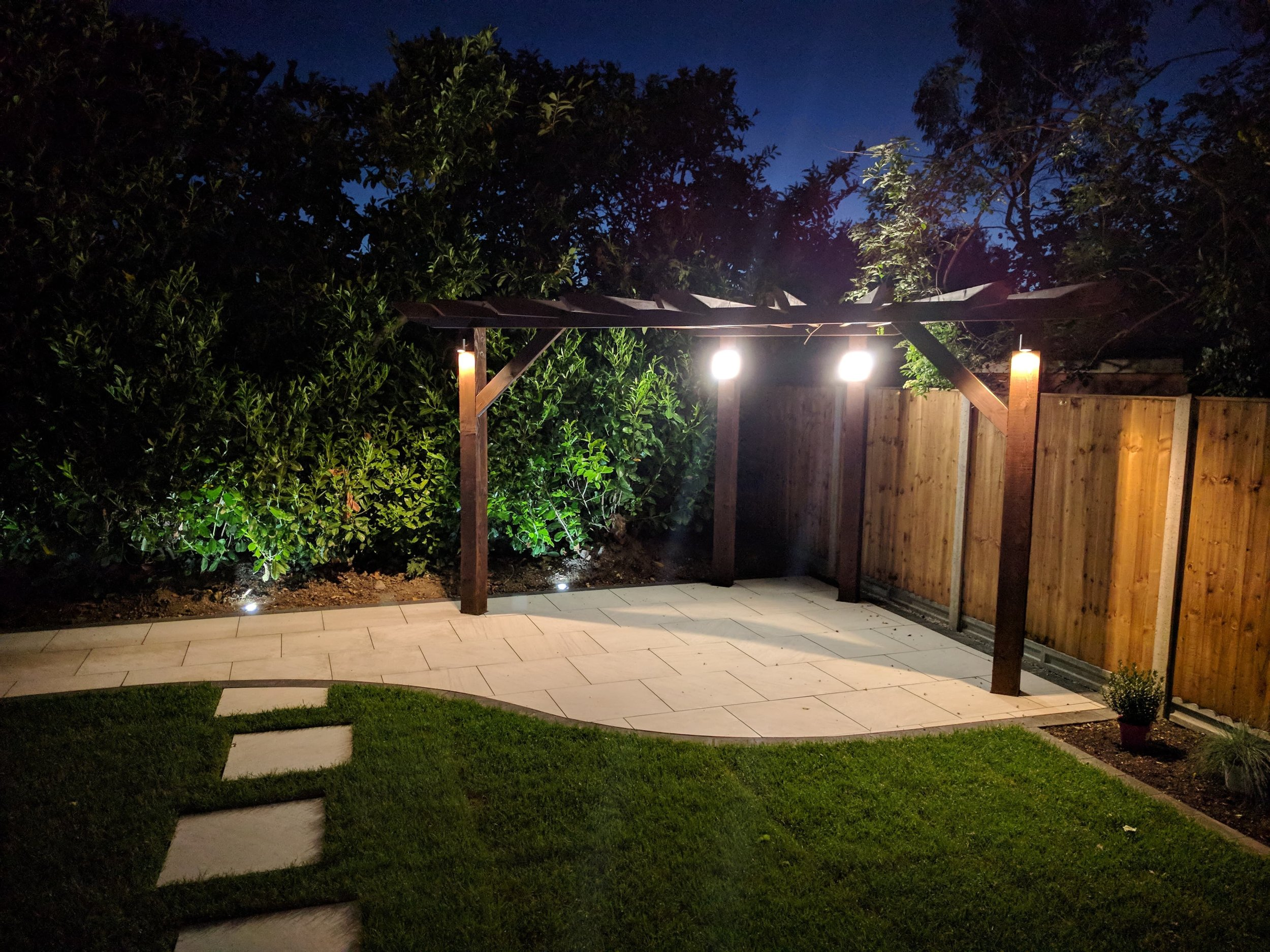 Lights installed on this pergola in a garden we transformed in Chichestermaking it a great space to use at night.