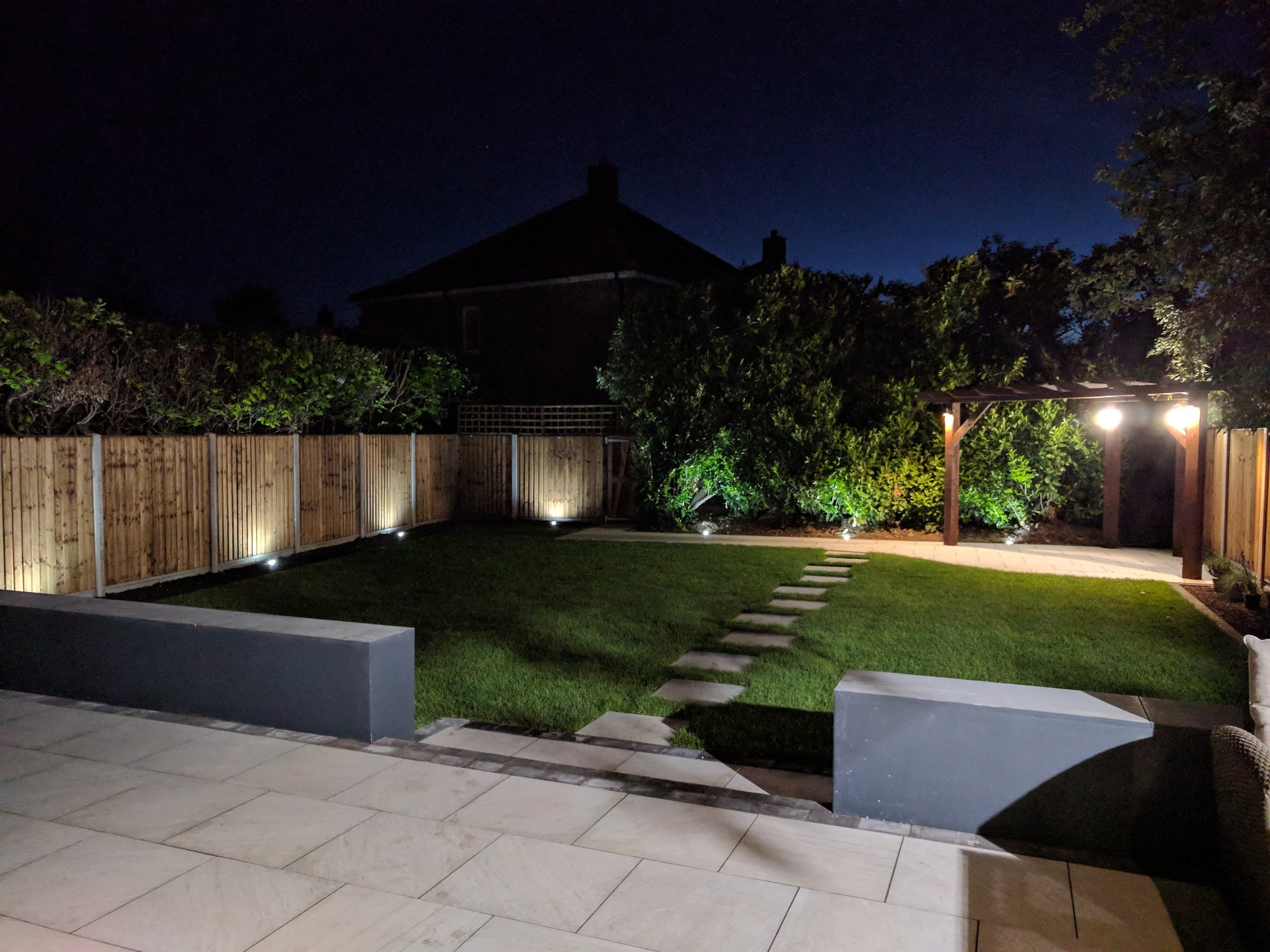 installing lights around this garden and new patio makes it all very useable at night.