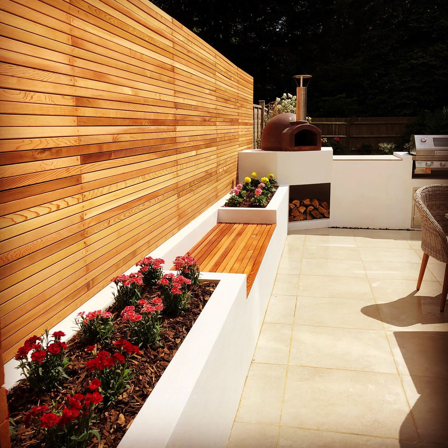 Garden patio with rendered walls and a cedar strip fence installed in Aldwick Bognor regis,