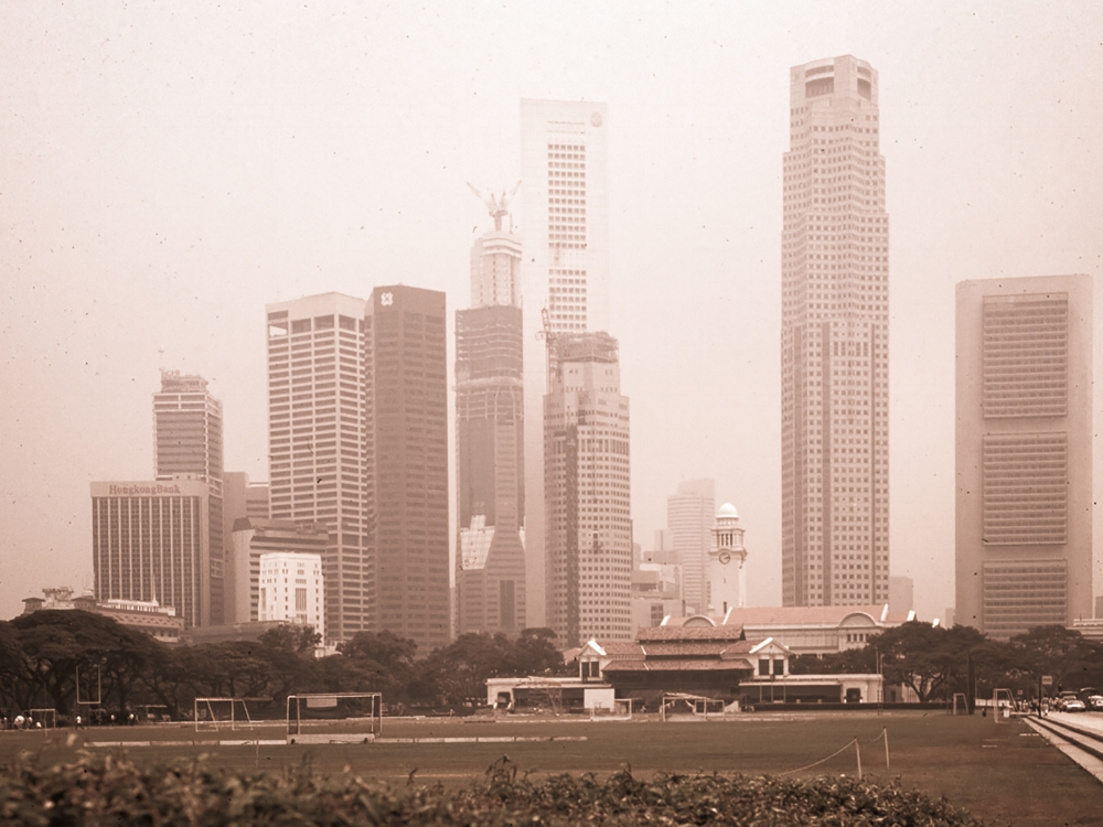 ... with the city being shrouded by the fumes from forest fires on Sumatra