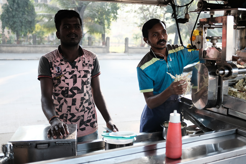 Sugarcane juice. (The empty street in the background? It is eight in the morning.)