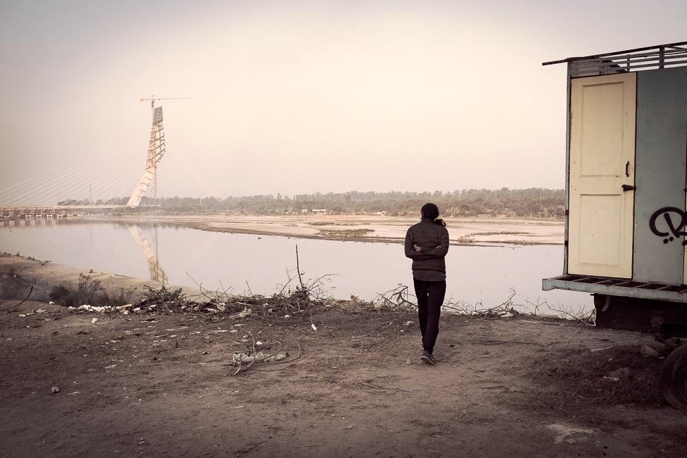 Bhushan carefully inspecting the construction progress of a new bridge across the Yamuna river.